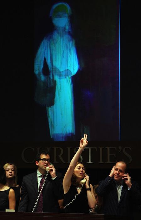 Christie's auction house staff place bid