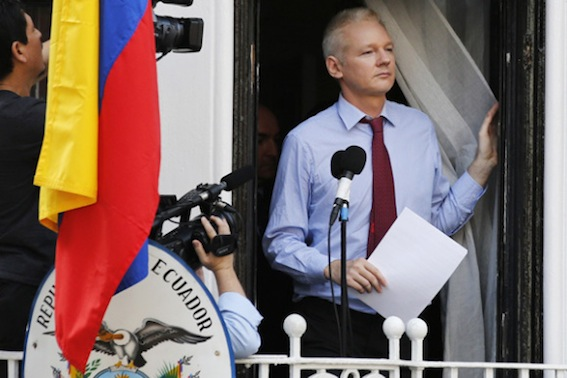 Wikileaks founder Julian Assange prepares to speak from the balcony of Ecuador's embassy, where he is taking refuge in London