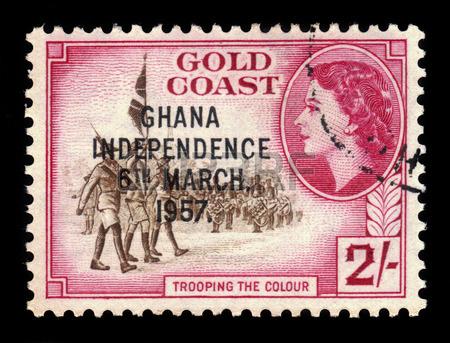 35015348-ghana--circa-1957-a-stamp-printed-in-ghana-shows-standard-bearers-and-queen-elizabeth-ii-stamp-of-go